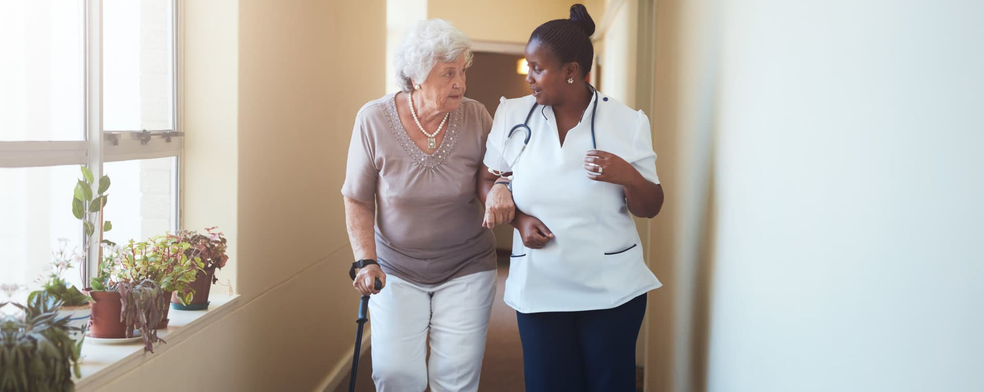nurse assisting an old woman